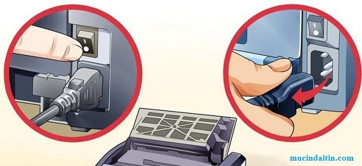 Cắm nguồn vào máy in và mở công tắc nguồn
